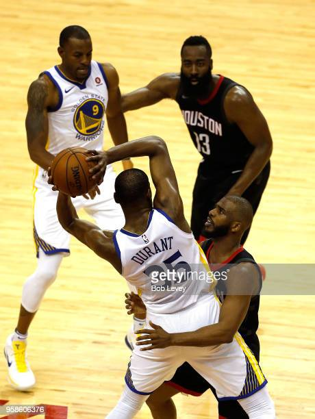 Chris Paul of the Houston Rockets defends Kevin Durant of the Golden State Warriors in the first half in Game One of the Western Conference Finals of...