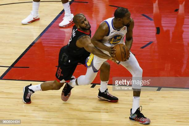 Chris Paul of the Houston Rockets defends Kevin Durant of the Golden State Warriors in the first half during Game Two of the Western Conference...