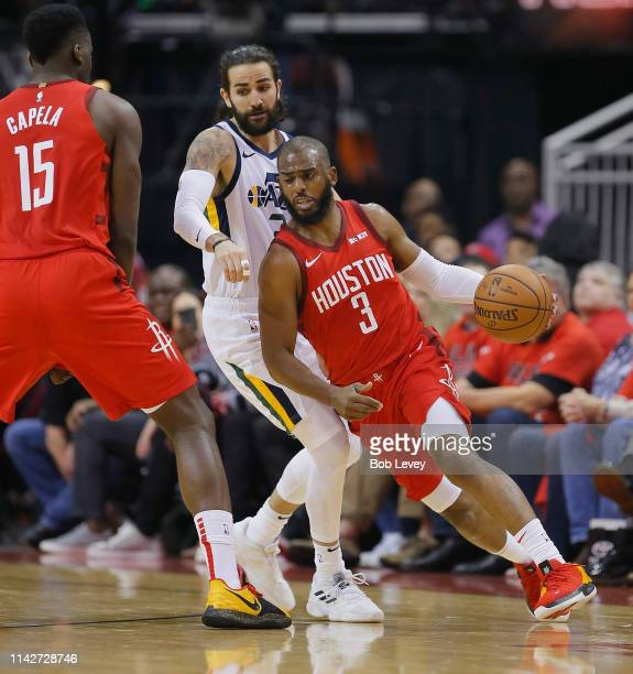 Chris Paul of the Houston Rockets dribbles around Ricky Rubio of the Utah Jazz as Clint Capela setes a pick in the first half during Game One of the...