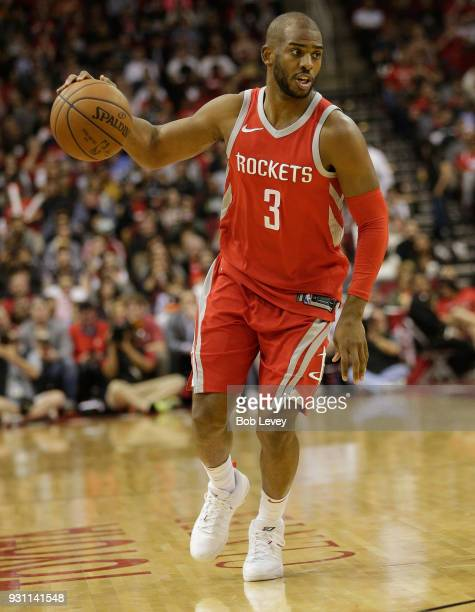 Chris Paul of the Houston Rockets dribbles the ball against the San Antonio Spurs at Toyota Center on March 12 2018 in Houston Texas NOTE TO USER...