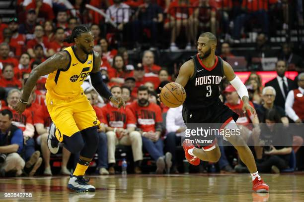 Chris Paul of the Houston Rockets dribbles the ball on a fast break pursued by Jae Crowder of the Utah Jazz in the second half during Game One of the...