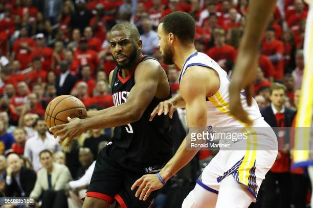 Chris Paul of the Houston Rockets drives against Stephen Curry of the Golden State Warriors in the first half of Game Two of the Western Conference...