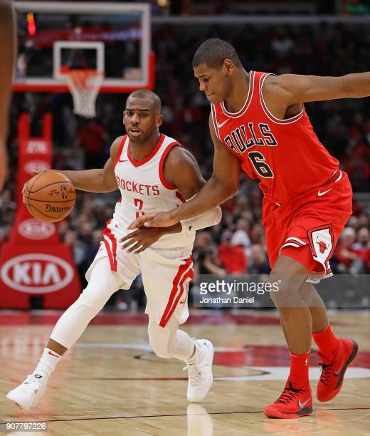Chris Paul of the Houston Rockets drives around Cristiano Felicio of the Chicago Bulls at the United Center on January 8 2018 in Chicago Illinois The...