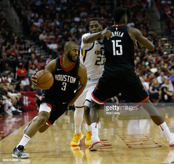 Chris Paul of the Houston Rockets drives past Royce O'Neale of the Utah Jazz as he receives a pick from Clint Capela during Game Five of the Western...