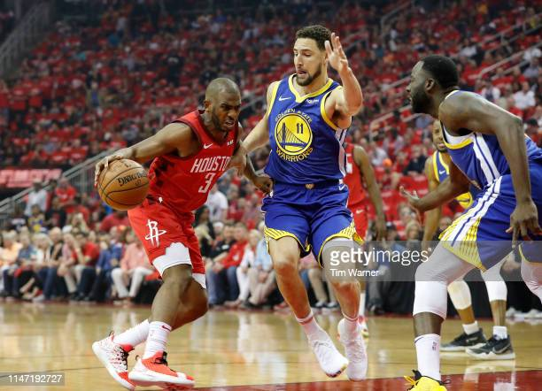 Chris Paul of the Houston Rockets drives to the basket defended by Klay Thompson of the Golden State Warriors in the first quarter during Game Three...