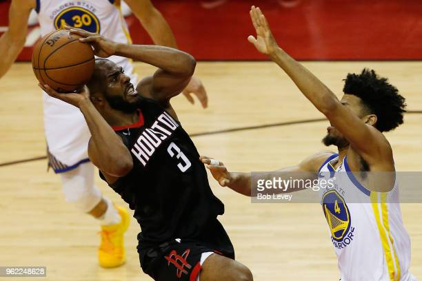 Chris Paul of the Houston Rockets goes up against Quinn Cook of the Golden State Warriors in the fourth quarter of Game Five of the Western...