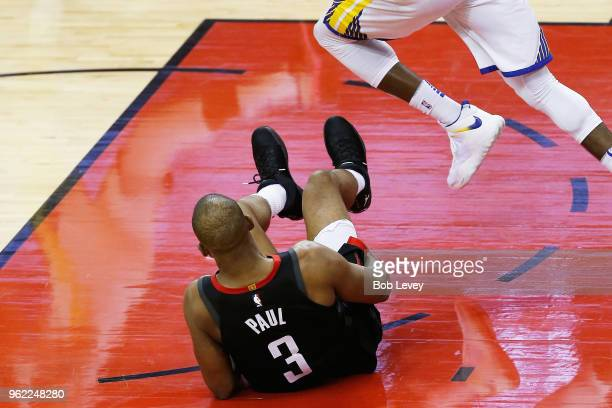 Chris Paul of the Houston Rockets grabs his leg after falling against the Golden State Warriors in the fourth quarter of Game Five of the Western...