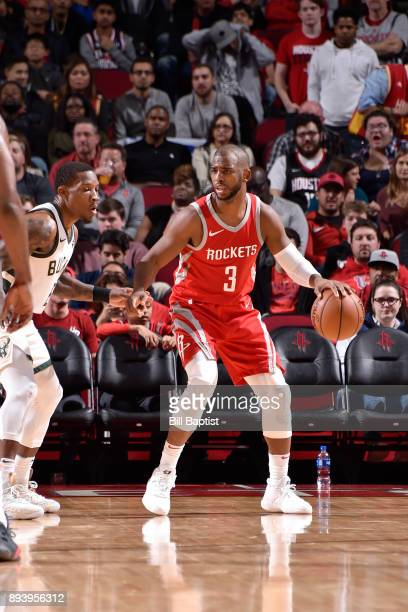 Chris Paul of the Houston Rockets handles the ball against the Milwaukee Bucks on December 16 2017 at the Toyota Center in Houston Texas NOTE TO USER...