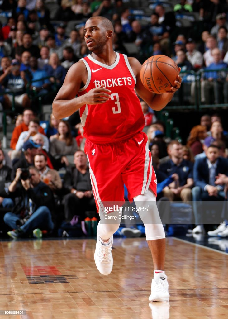 Chris Paul #3 of the Houston Rockets handles the ball against the Dallas Mavericks on January 24, 2018 at the American Airlines Center in Dallas, Texas.
