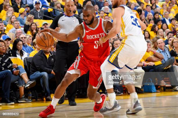 Chris Paul of the Houston Rockets handles the ball against the Golden State Warriors during Game Three of the Western Conference Finals during the...