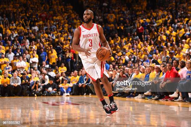 Chris Paul of the Houston Rockets handles the ball against the Golden State Warriors in Game Four of the Western Conference Finals of the 2018 NBA...