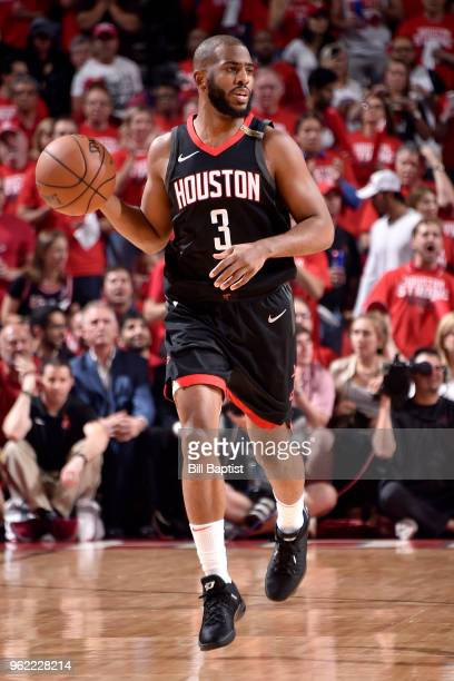 Chris Paul of the Houston Rockets handles the ball against the Golden State Warriors in Game Five of the Western Conference Finals during the 2018...