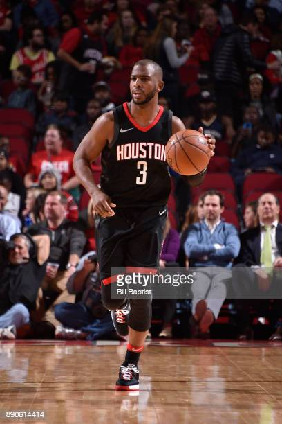 Chris Paul of the Houston Rockets handles the ball against the New Orleans Pelicans on December 11 2017 at the Toyota Center in Houston Texas NOTE TO...