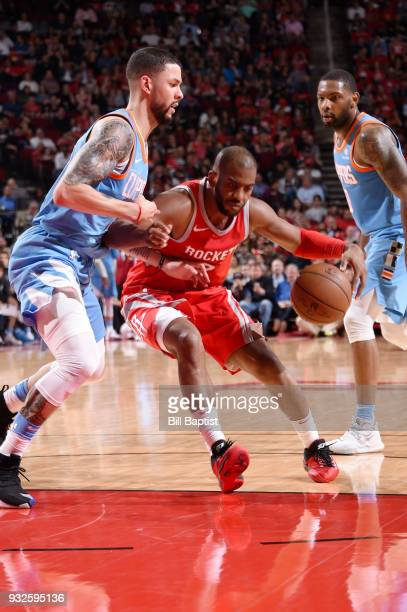 Chris Paul of the Houston Rockets handles the ball against the LA Clippers on March 15 2018 at the Toyota Center in Houston Texas NOTE TO USER User...