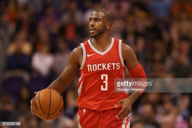 Chris Paul of the Houston Rockets handles the ball during the first half of the NBA game against the Phoenix Suns at Talking Stick Resort Arena on...
