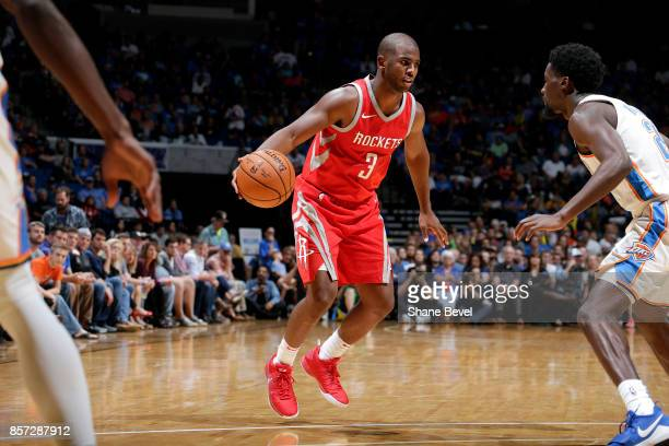 Chris Paul of the Houston Rockets handles the ball during the preseason game against the Oklahoma City Thunder on October 3 2017 at the BOK Center in...