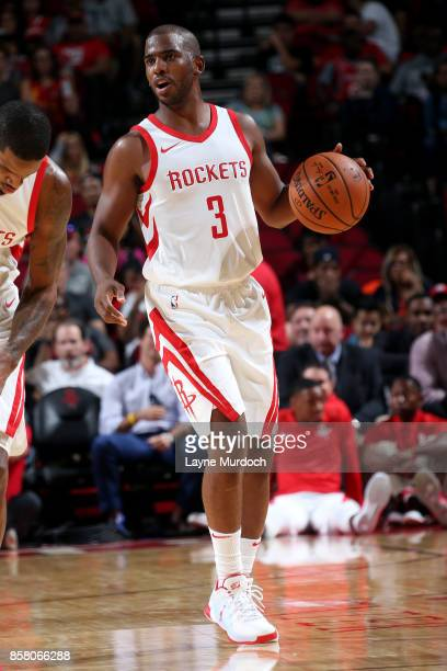 Chris Paul of the Houston Rockets handles the ball during the preseason game against the Shanghai Sharks on October 5 2017 at the Toyota Center in...