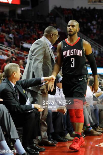 Chris Paul of the Houston Rockets is greeted by assistant coach Jeff Bzdelik in the fourth quarter at Toyota Center on November 27 2017 in Houston...
