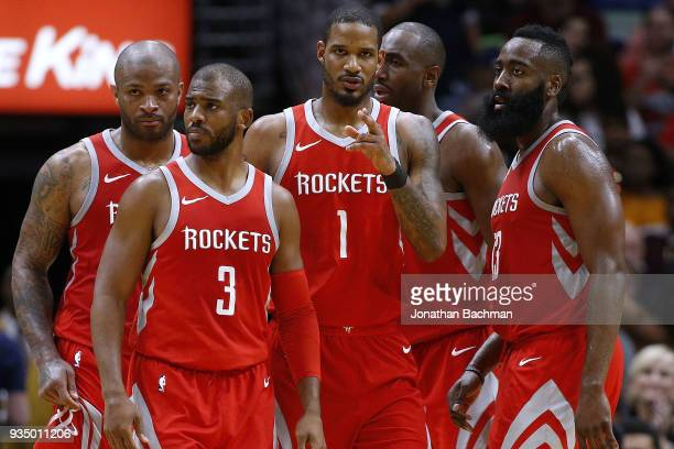 Chris Paul of the Houston Rockets James Harden Trevor Ariza Luc Mbah a Moute and PJ Tucker talk during the second half against the New Orleans...