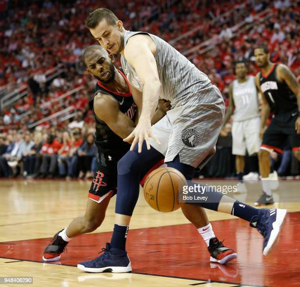Chris Paul of the Houston Rockets knocks the ball away from Nemanja Bjelica of the Minnesota Timberwolves during Game Two of the first round of the...