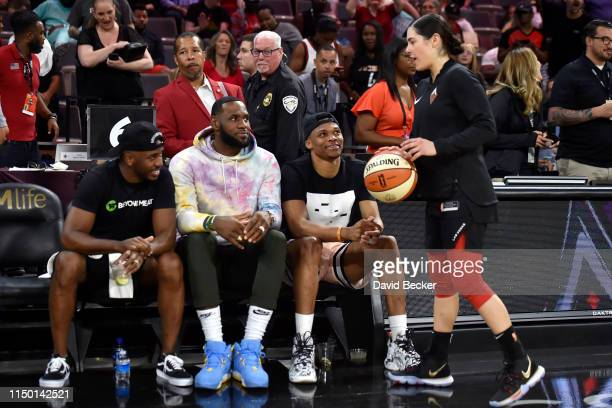 Chris Paul of the Houston Rockets LeBron James of the Los Angeles Lakers and Russell Westbrook of the Oklahoma City Thunder speak with Kelsey Plum of...