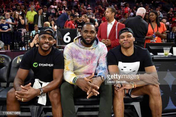 Chris Paul of the Houston Rockets LeBron James of the Los Angeles Lakers and Russell Westbrook of the Oklahoma City Thunder attend the game between...