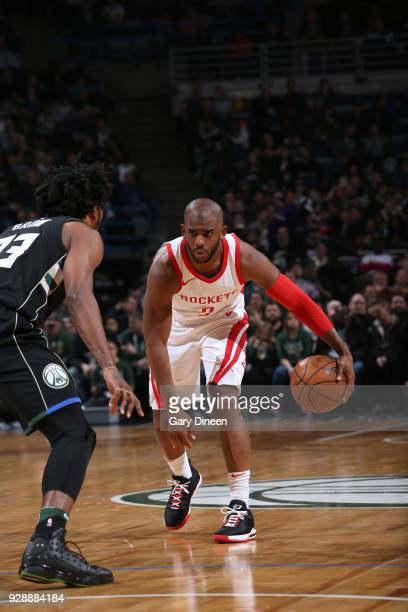 Chris Paul of the Houston Rockets looks to drive against Sterling Brown of the Milwaukee Bucks during the NBA game on March 7 2018 at the BMO Harris...