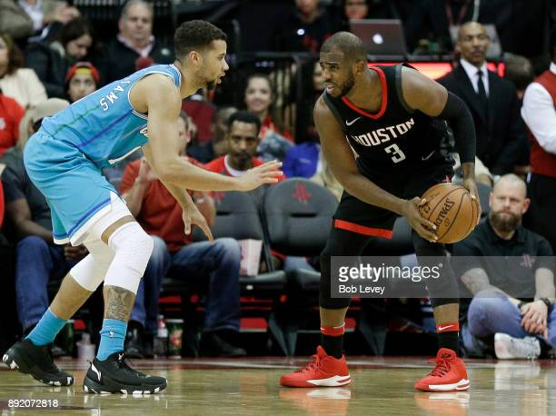 Chris Paul of the Houston Rockets looks to drive on Michael CarterWilliams of the Charlotte Hornets in the fourth qaurter at Toyota Center on...