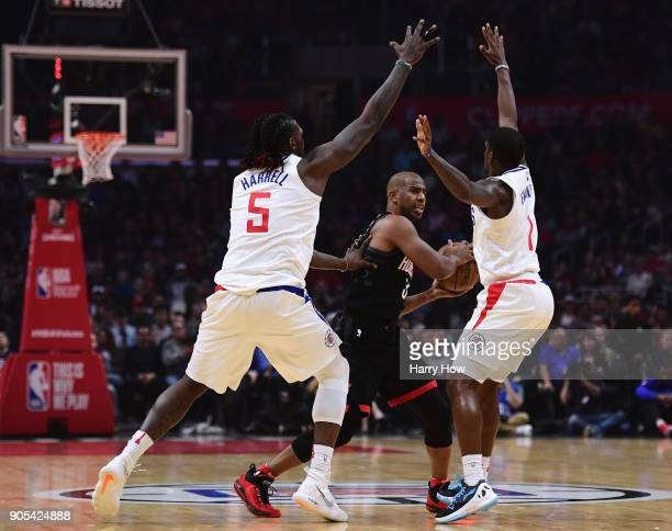 Chris Paul of the Houston Rockets looks to pass between Montrezl Harrell and Jawun Evans of the LA Clippers during the first half at Staples Center...