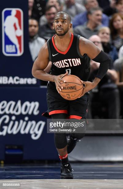 Chris Paul of the Houston Rockets looks to pass the ball during their game against the Utah Jazz at Vivint Smart Home Arena on December 7 2017 in...