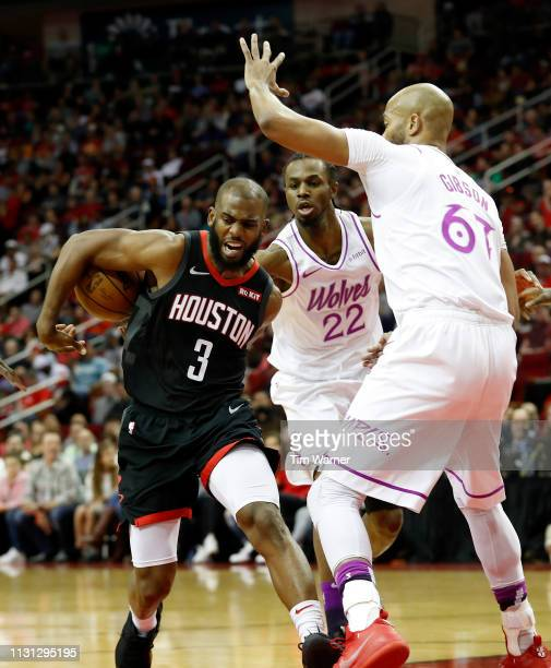 Chris Paul of the Houston Rockets looses control of the ball defended by Andrew Wiggins of the Minnesota Timberwolves and Taj Gibson in the first...