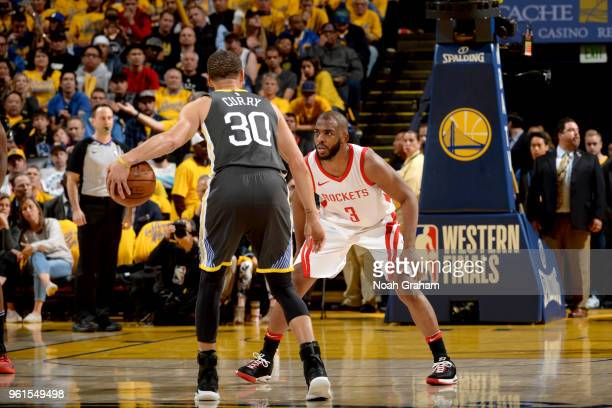 Chris Paul of the Houston Rockets plays defense against the Golden State Warriors in Game Four of the Western Conference Finals of the 2018 NBA...