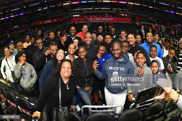 Chris Paul of the Houston Rockets poses for a photo with fans before the game against the LA Clippers on January 15 2018 at STAPLES Center in Los...