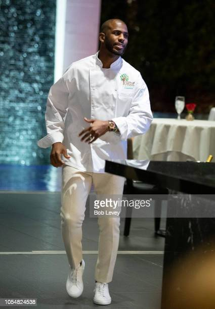 Chris Paul of the Houston Rockets prepares to serve guests at the Chris Paul Family Foundation's Celebrity Server Fundraiser at Mastro's Steakhouse...