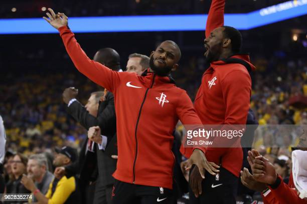 Chris Paul of the Houston Rockets reacts to a threepoint basket against the Golden State Warriors during Game Six of the Western Conference Finals in...