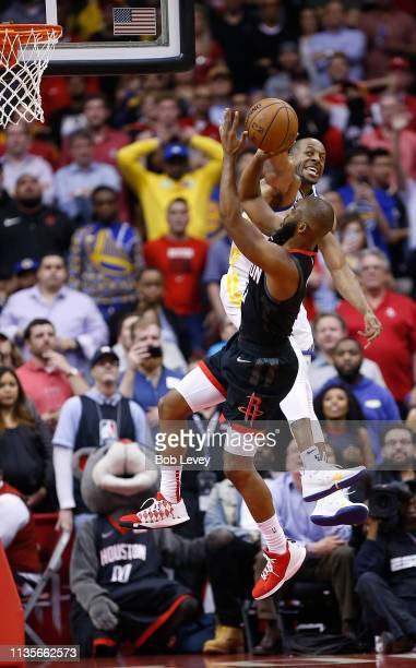 Chris Paul of the Houston Rockets shoots and is fouled by Andre Iguodala of the Golden State Warriors during the fourth quarter at Toyota Center on...