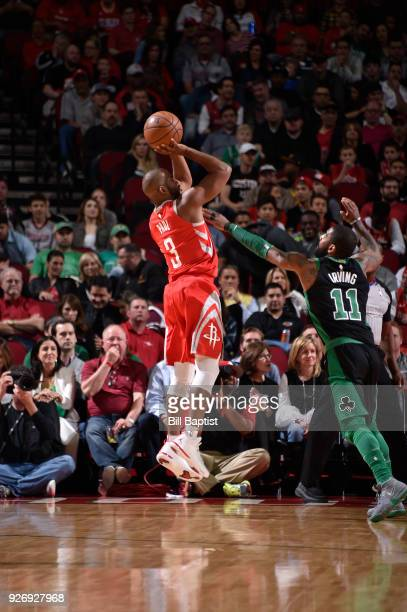 Chris Paul of the Houston Rockets shoots the ball against the Boston Celtics on March 3 2018 at the Toyota Center in Houston Texas NOTE TO USER User...