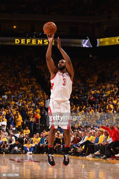 Chris Paul of the Houston Rockets shoots the ball against the Golden State Warriors in Game Four of the Western Conference Finals of the 2018 NBA...