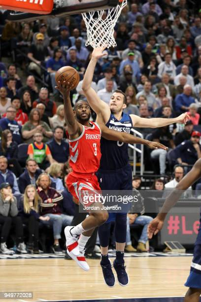 Chris Paul of the Houston Rockets shoots the ball against the Minnesota Timberwolves in Game Three of Round One of the 2018 NBA Playoffs on April 21...