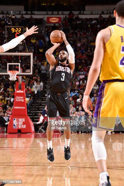 Chris Paul of the Houston Rockets shoots the ball against the Los Angeles Lakers on December 13 2018 at the Toyota Center in Houston Texas NOTE TO...