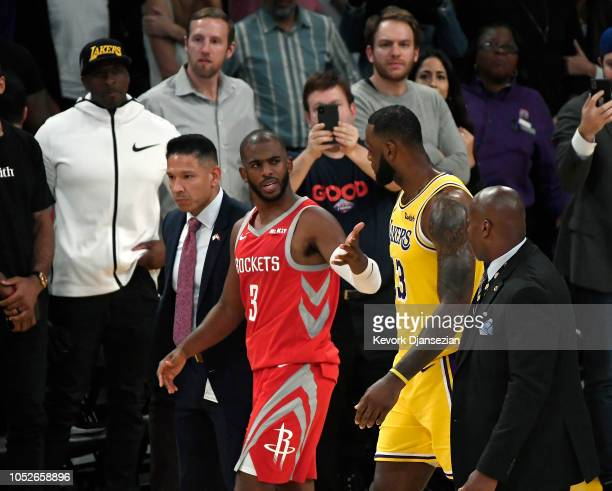 Chris Paul of the Houston Rockets speaks with LeBron James of the Los Angeles Lakers after he was ejected for fighting during the second half of a...