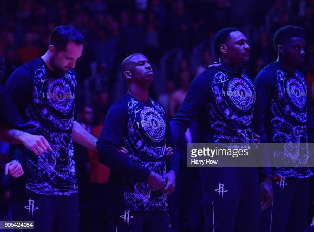 Chris Paul of the Houston Rockets stands for the National Anthem with his teammates before the game against the LA Clippers at Staples Center on...