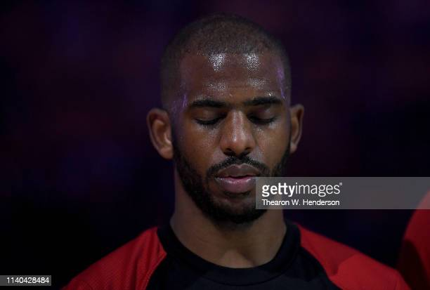 Chris Paul of the Houston Rockets stands with his eyes closed during the singing of the National Anthem prior to playing the Golden State Warriors in...