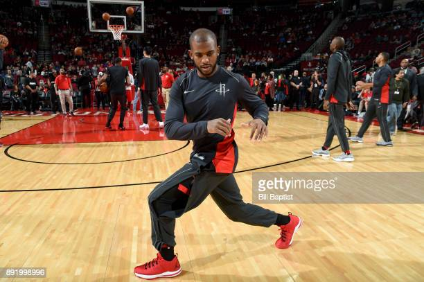 Chris Paul of the Houston Rockets stretches before the game against the Charlotte Hornets on December 13 2017 at the Toyota Center in Houston Texas...