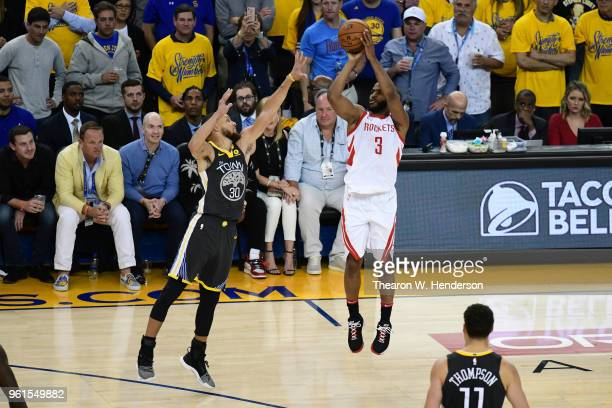 Chris Paul of the Houston Rockets takes a shot against Stephen Curry of the Golden State Warriors during Game Four of the Western Conference Finals...
