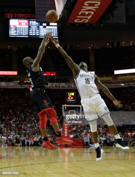 Chris Paul of the Houston Rockets takes a shot defended by Isaiah Whitehead of the Brooklyn Nets in the second half at Toyota Center on November 27...