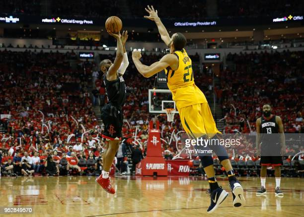 Chris Paul of the Houston Rockets takes a three point shot defended by Rudy Gobert of the Utah Jazz in the second half during Game One of the Western...
