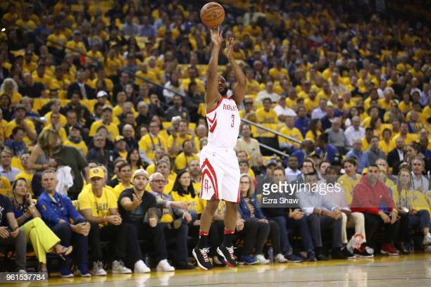 Chris Paul of the Houston Rockets takes an open threepoint shot against the Golden State Warriors during Game Four of the Western Conference Finals...