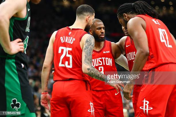 Chris Paul of the Houston Rockets talks to his teammates as Aron Baynes of the Boston Celtics looks on during a game at TD Garden on March 3 2019 in...