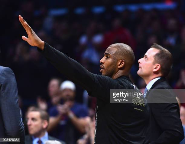 Chris Paul of the Houston Rockets waves to the crowd in response to applause in his return to play his former team the LA Clippers during the first...